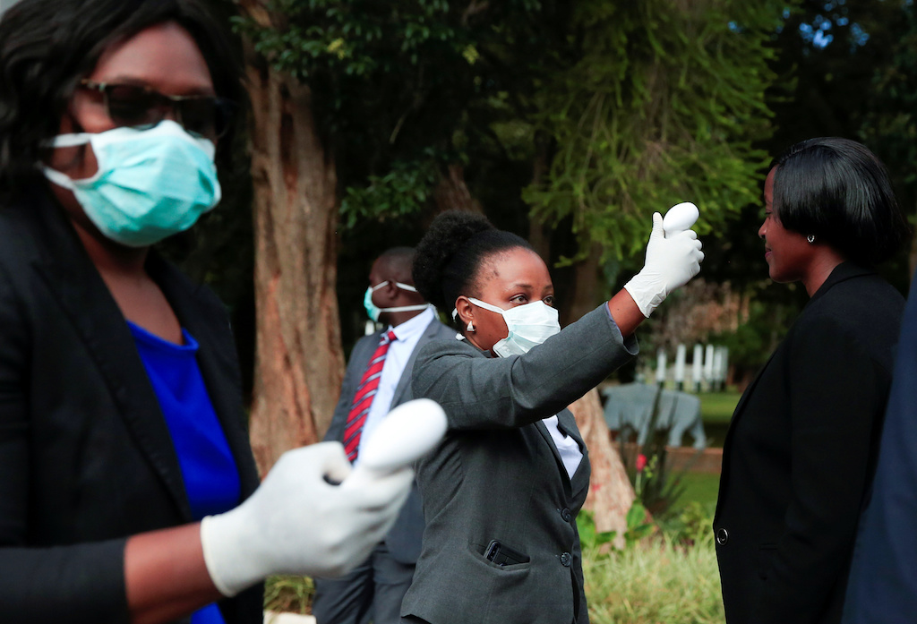 Health workers screen visitors to prevent the spread of coronavirus disease (COVID-19) at State House in Harare, Zimbabwe.