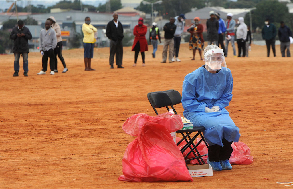 A medical practitioner awaits for a patient to test for COVID-19 in Alexandra township, residents gathered to be screened and tested for coronavirus, the campaign is targeting Johannesburg epicenter.