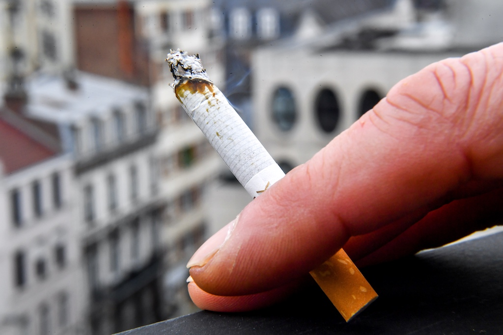 A cigarette smoker is pictured on March 1, 2018, in Lille, northern France, on the day when the price of a packet of cigarettes was increased by one euro to fight against smoking. The government plans regular increases to bring the cost of a packet to 10 euros by 2020.