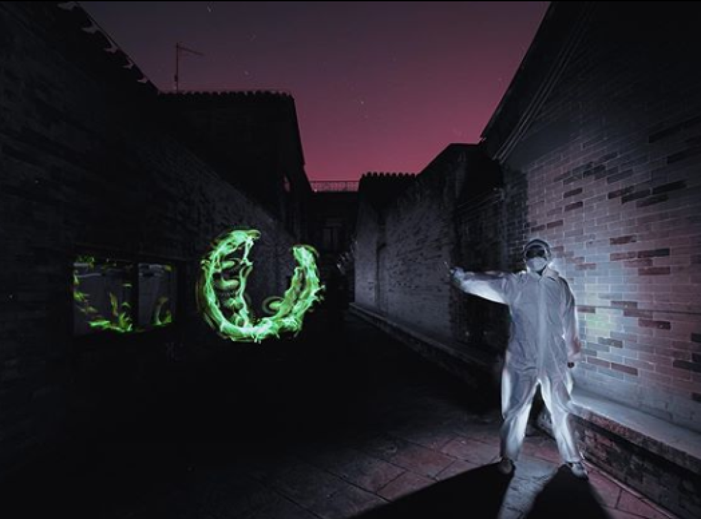 "Roy Wang and his team used the photographic technique of light painting to ""draw"" art inspired by the fight against the spread and impact of the COVID-19 virus."