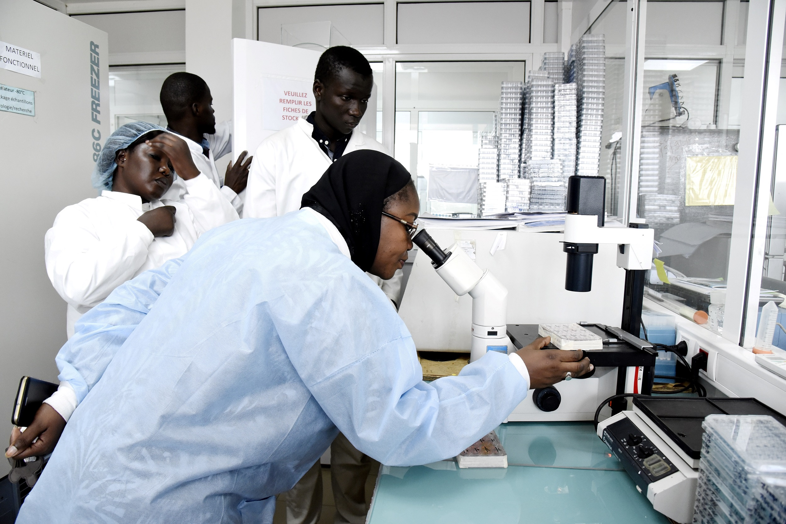 Scientific staff work in a secure laboratory, researching the coronavirus, at the Pasteur Institute in Dakar.