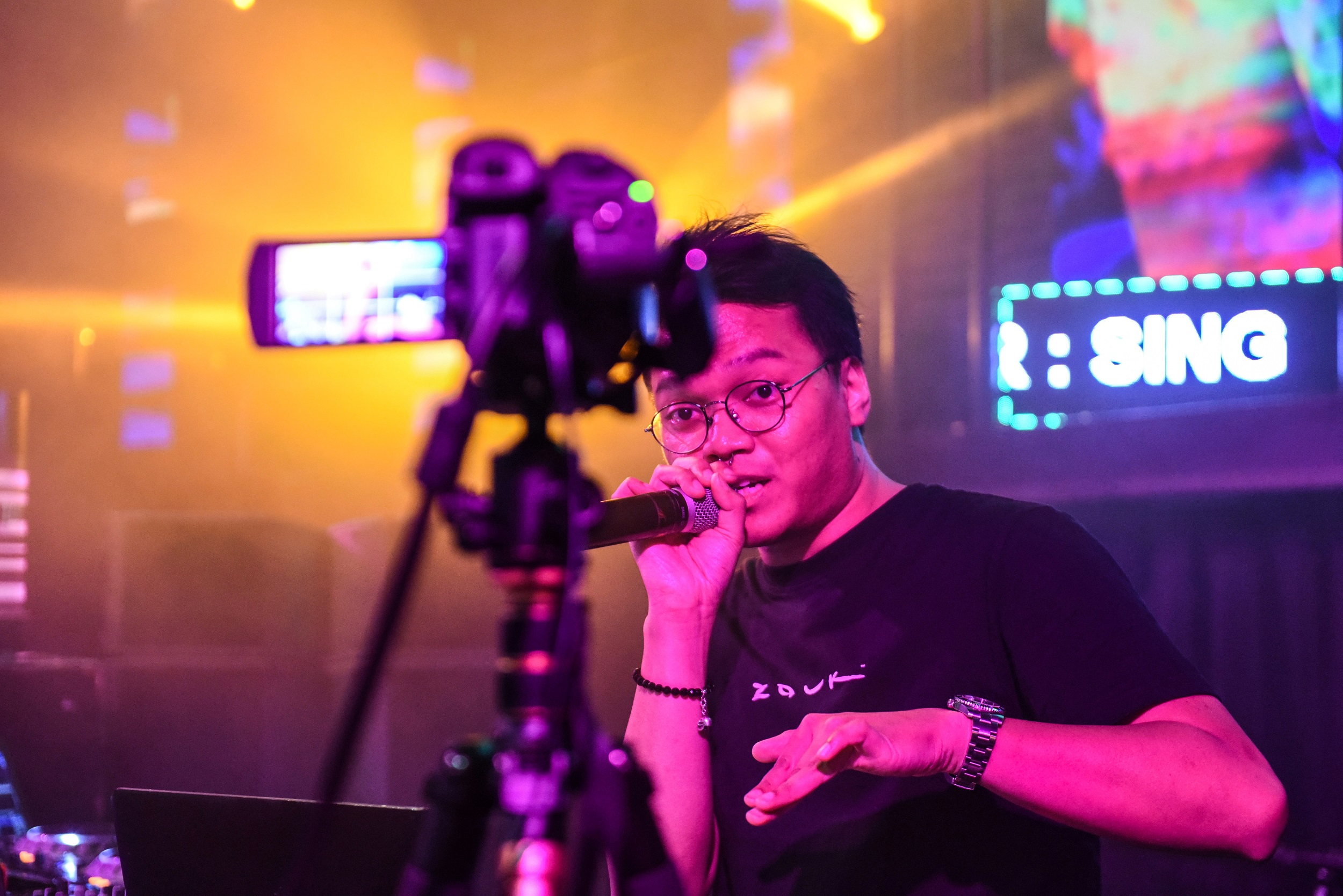 "Zouk's DJ Mr J performing in front of a video camera during a ""cloud-clubbing"" party that was live-streamed following the temporary closure of entertainment venues in Singapore."