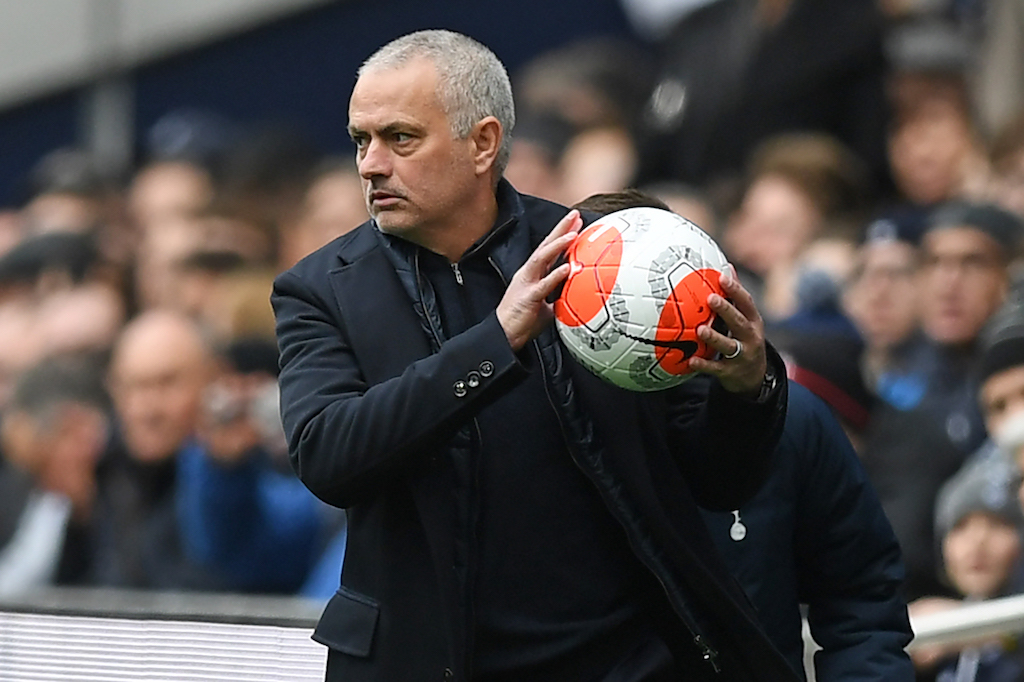 Tottenham Hotspur's Portuguese head coach Jose Mourinho returns the ball during the English Premier League football match between Tottenham Hotspur and Wolverhampton Wanderers at the Tottenham Hotspur Stadium in London, on March 1, 2020.