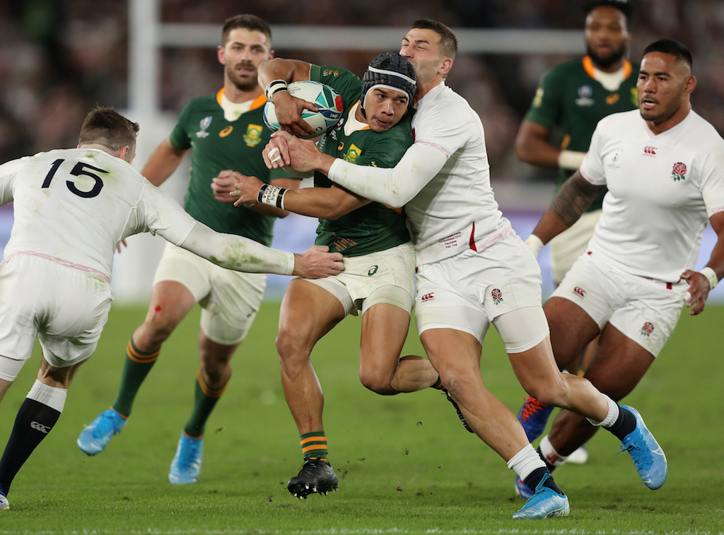 South Africa's Cheslin Kolbe (centre) during the 2019 Rugby World Cup final match at Yokohama Stadium.