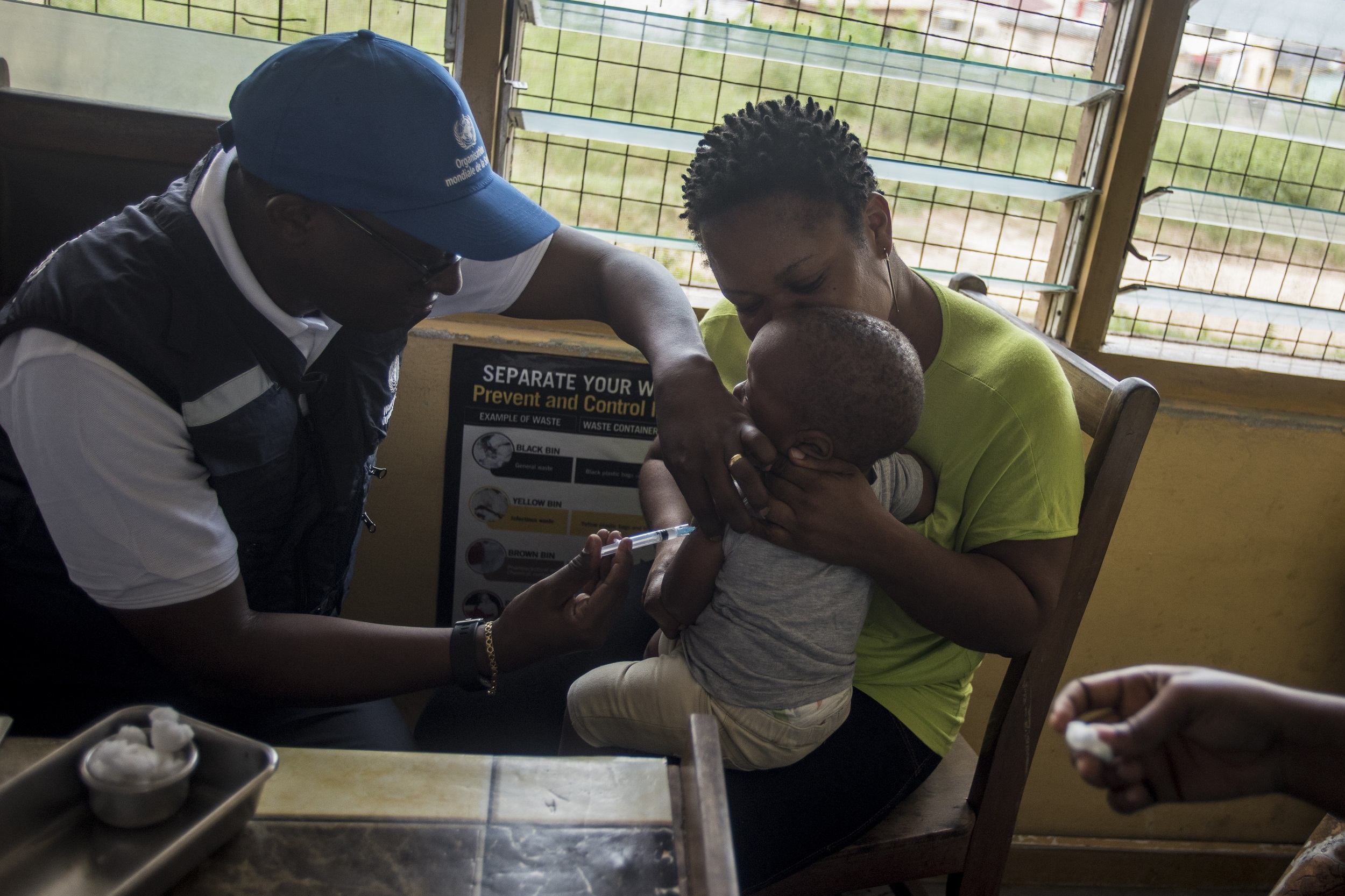 A World Health Organization (WHO) doctor administers a malaria vaccine to a child in Ghana.