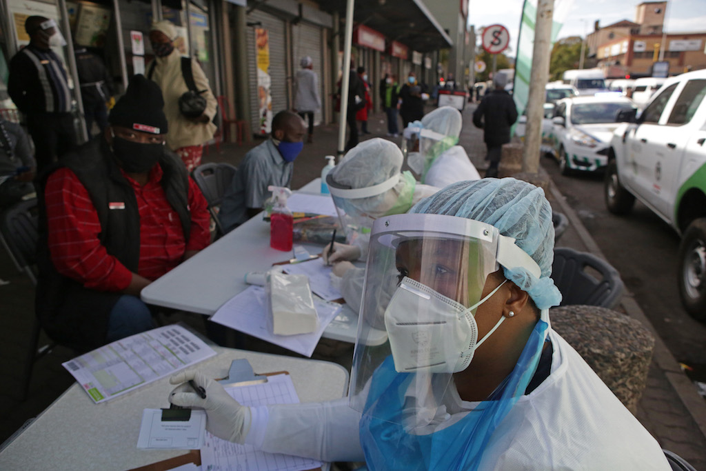 File: A City of Tshwane Health official looks on as she conducts a screening exercise on a taxi operator before testing for the COVID-19 coronavirus at the Bloed Street Mall in Pretoria Central Business District.