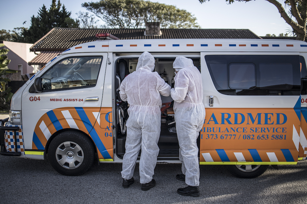 A crew of a private ambulance service in Port Elizabeth wear personal protective equipment (PPE), on July 11, 2020 ahead of checking on a patient affected by COVID-19 coronavirus at her home.