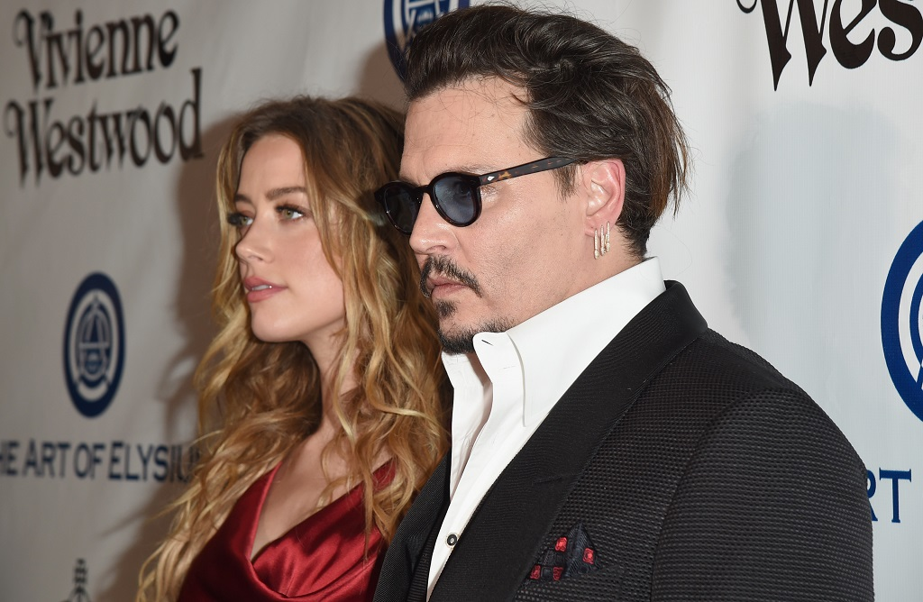 Amber Heard claims she punched Johnny Depp to save her sister