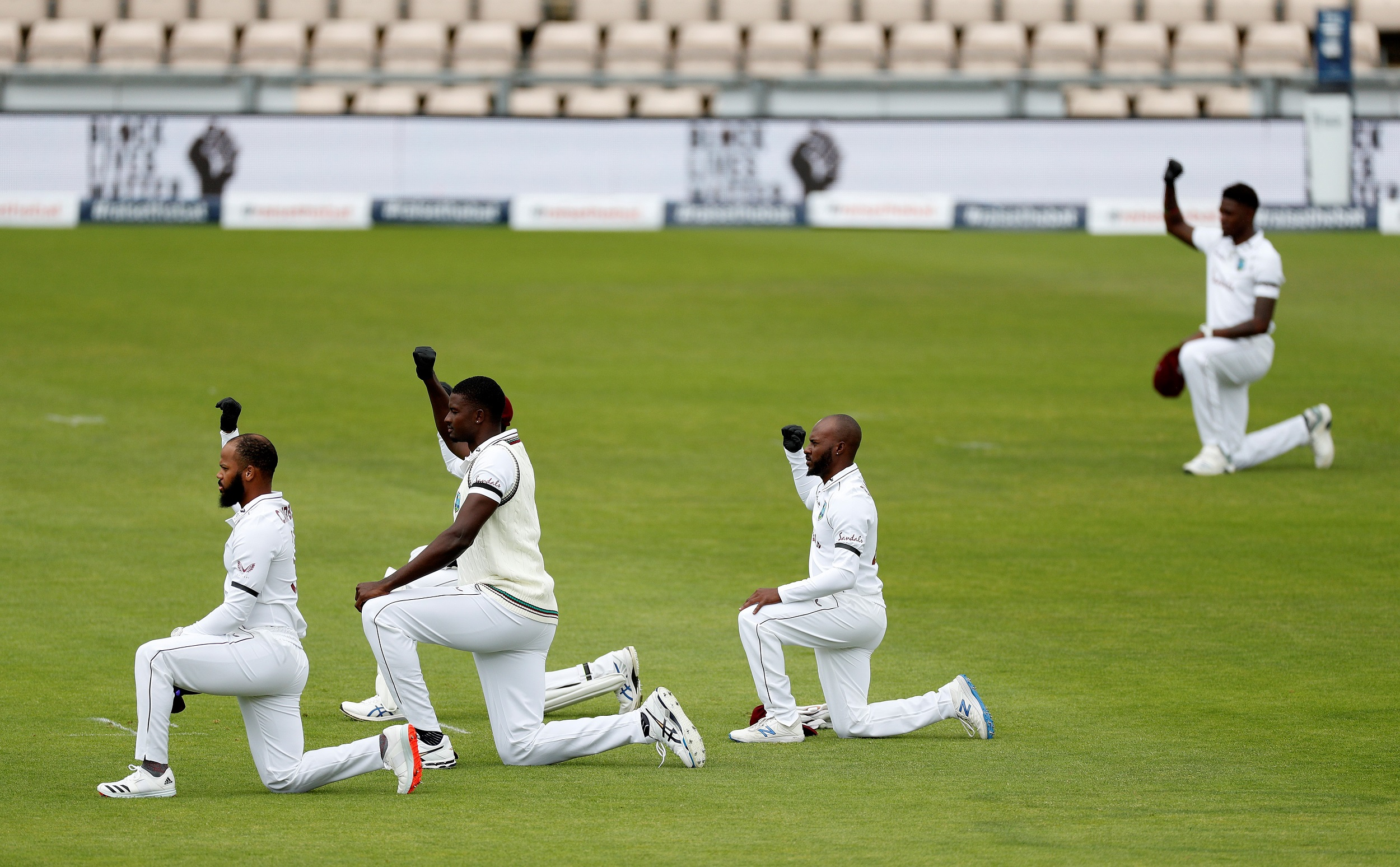 Players takes a knee in support of the Black Lives Matter movement on the first day of the first Test cricket match between England and the West Indies.
