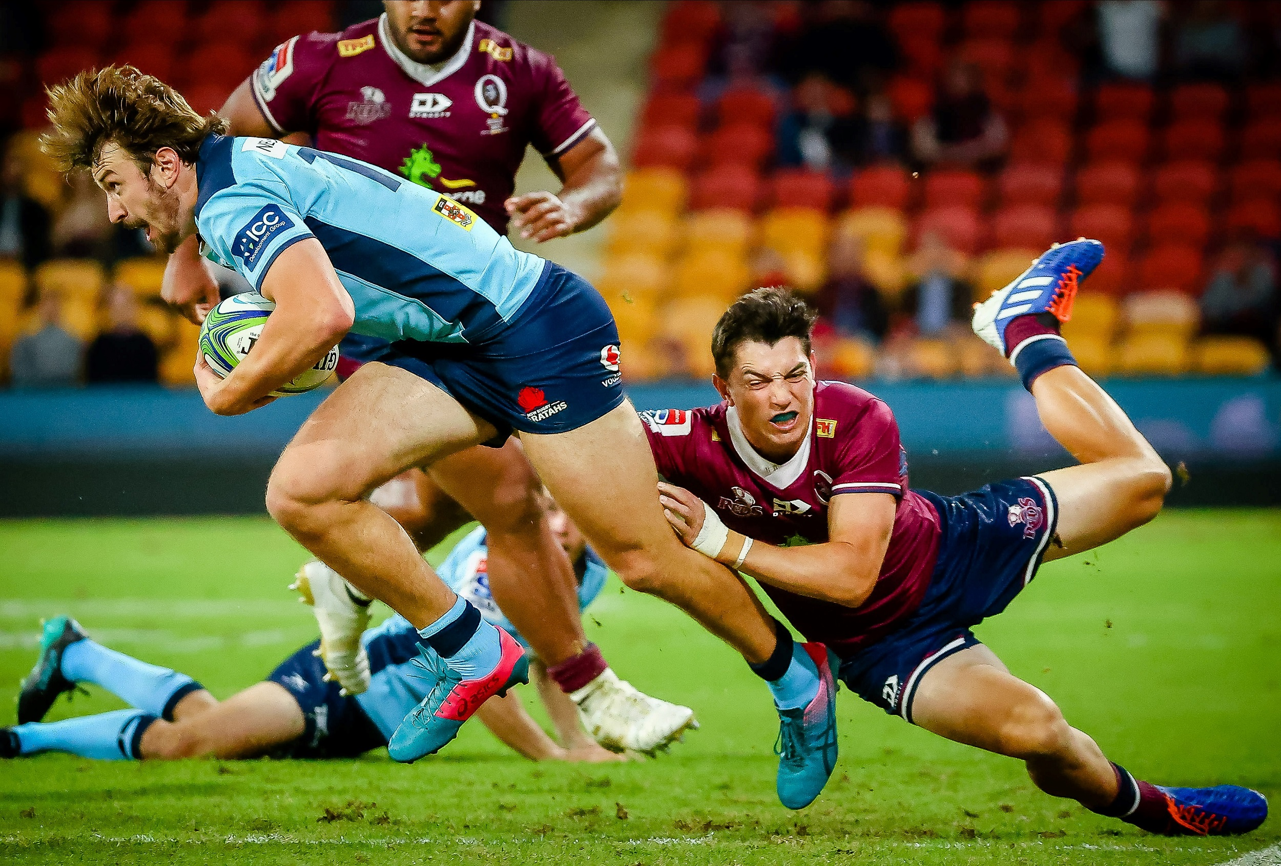 Waratahs' James Ramm (L) is tackled by Reds' Jock Campbell during the Super Rugby match at Suncorp Stadium in Brisbane.