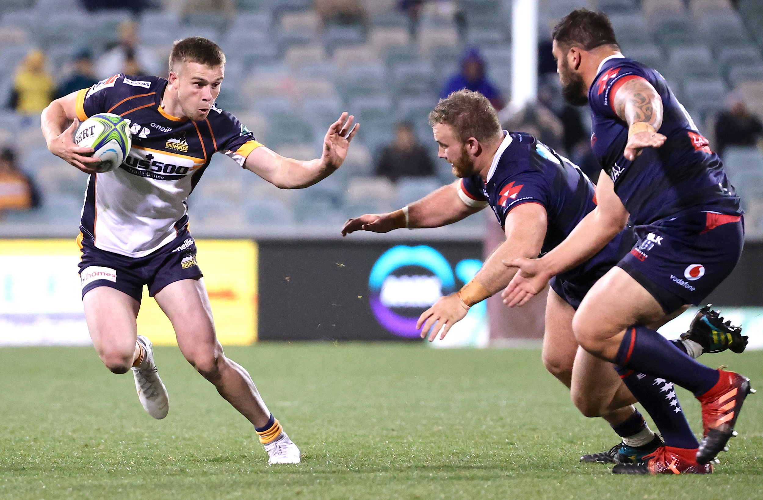 Mack Hansen (L) of the Brumbies runs with the ball during the Super Rugby match between the ACT Brumbies and Melbourne Rebels in Canberra.