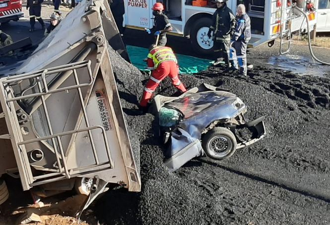 A truck carrying coal overturned onto a small car on the N12.