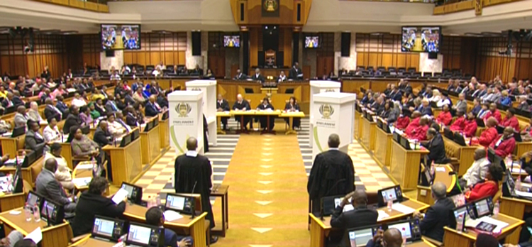File: Various South African political leaders present in the National Assembly.