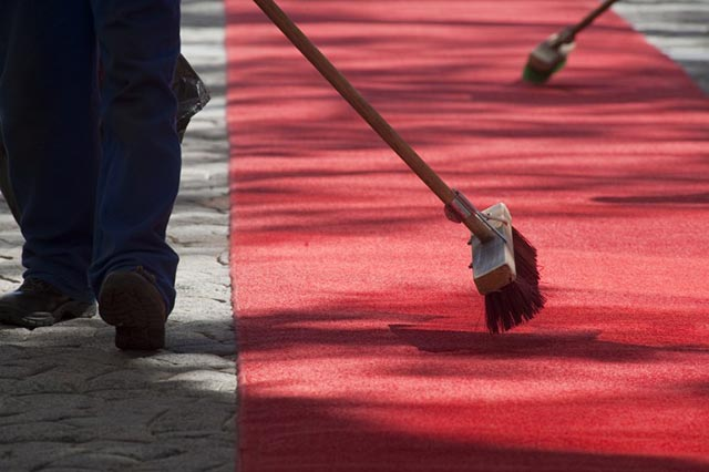 Workers sweep the red carpet at Parliament, before the state of the nation speech by South African President Jacob Zuma, in Cape Town South Afric