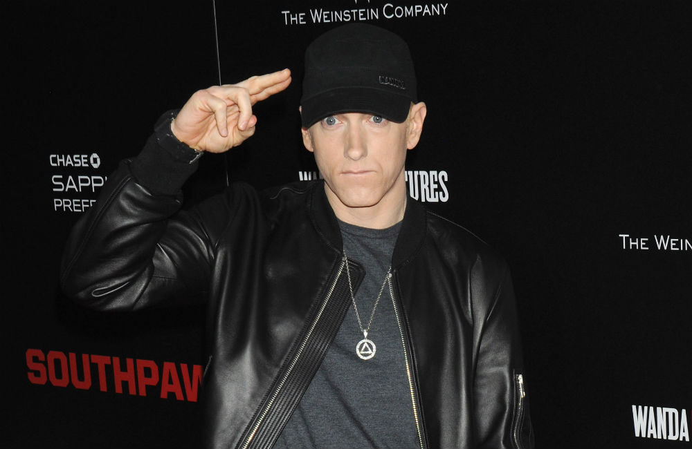 File: Eminem surprised fans last week when he unexpectedly dropped the album, which saw combined chart sales of 55,000 units in the past week.