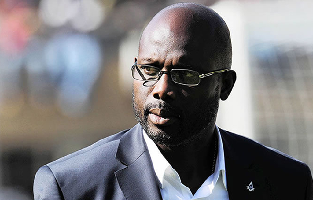 File: Former AC Milan striker and current Liberia president George Weah.