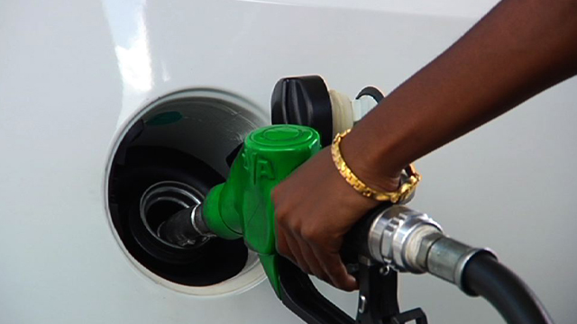 File: Petrol being poured into a car.