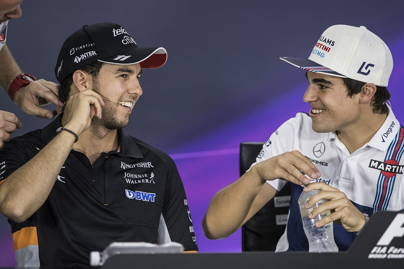 Mexican Formula One driver Sergio Perez of Sahara Force India F1 Team (L) and Canadian Formula One driver Lance Stroll of Williams during a press conference at the Gilles Villeneuve circuit.