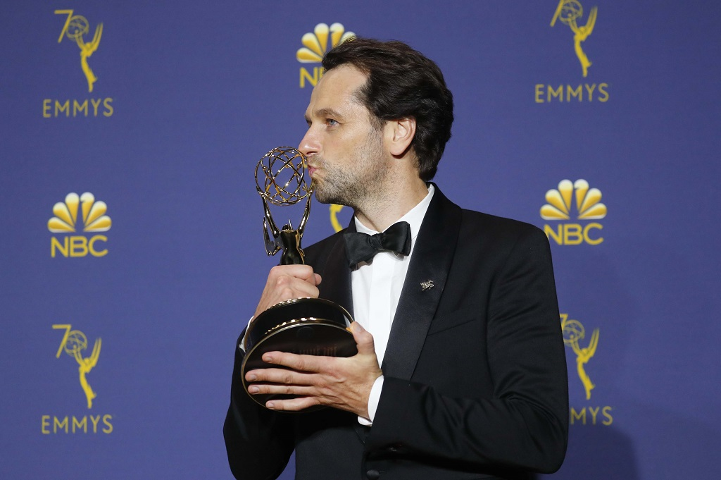 Matthew Rhys kisses his Emmy for Outstanding Lead Actor in a Drama series. REUTERS/Mike Blake
