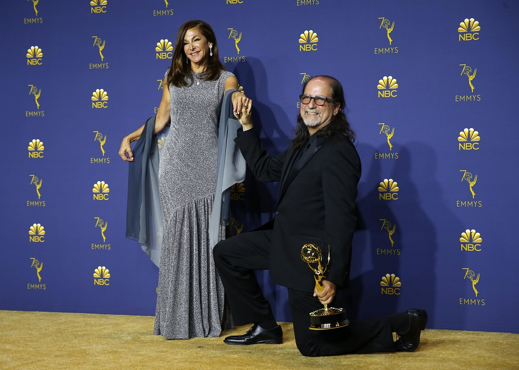 "Los Angeles, California, U.S., 17/09/2018 - Glenn Weiss poses backstage with his Outstanding Directing for a Variety Special award for ""The Oscars"" and with Jan Svendsen, after he proposed marriage to her on stage during the show. REUTERS/Mike Blake"