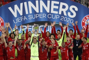 File: Bayern Munich's German goalkeeper Manuel Neuer and his teammates celebrate with the trophy after the UEFA Super Cup football match between FC Bayern Munich and Sevilla FC at the Puskas Arena in Budapest, Hungary on September 24, 2020.