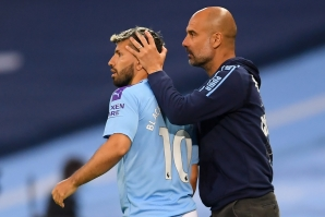 Pep Guardiola puts his hands on striker Sergio Aguero