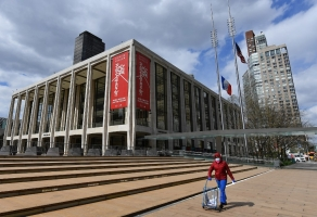 A woman pushes a cart outside Lincoln Center and the New York Philharmonic on April 16, 2020 in New York City.