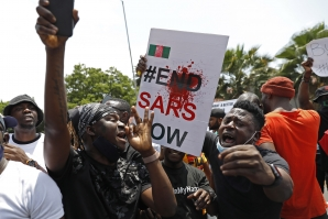 File: Nigerians based in South Africa protest outside their embassy in Pretoria on October 21, 2020 in solidarity with Nigerian youth who are demanding an end to police brutality in the form of The Nigerian Police Force Unit, Special Anti-Robbery Squad (SARS). Phill Magakoe / AFP
