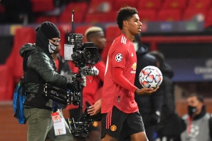 Manchester United's English striker Marcus Rashford leaves the pitch with the matchball after winning the UEFA Champions league group H football match between Manchester United and RB Leipzig at Old Trafford stadium in Manchester, north west England, on October 28, 2020. Manchester United won the match 5-0.