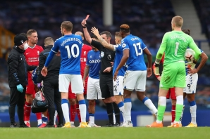 Referee Michael Oliver shows the red card to Everton's Brazilian striker Richarlisonduring the English Premier League football match between Everton and Liverpool at Goodison Park in Liverpool, north west England on October 17, 2020.
