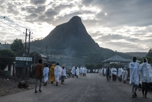 File: People walk to the church near the village of Tekeldengy, Northwest of Gondar, Ethiopia, on November 8, 2020. EDUARDO SOTERAS / AFP