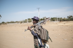 A member of the Amhara militia walks past the 5th Battalion of the Northern Command of the Ethiopian Army in Dansha, Ethiopia, on November 25, 2020.