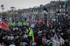 "Protesters march in Paris on November 28, 2020 during a protest against the ""global security"" draft law, which Article 24 would criminalise the publication of images of on-duty police officers with the intent of harming their ""physical or psychological integrity""."