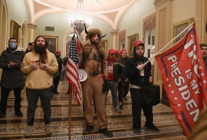 Supporters of US President Donald Trump enter the US Capitol on January 6, 2021, in Washington, DC. Demonstrators breeched security and entered the Capitol as Congress debated the a 2020 presidential election Electoral Vote Certification. Saul LOEB / AFP
