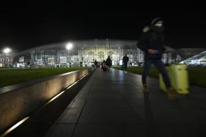 A picture taken on January 10, 2021 shows people leaving the main train station in Strasbourg, eastern France, as a new curfew is in effect at 6 pm to fight against the spread of the new coronavirus.