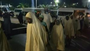 Girls wearing hijabs gathered at Zamfara state government premises as all 279 students kidnapped from their boarding school in northern Nigeria have been released.