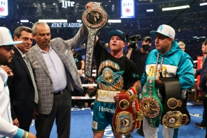 "One title to go: Saul ""Canelo"" Alvarez shows off his championship belts after defeating Billy Joe Saunders during their super middleweight unification fight"