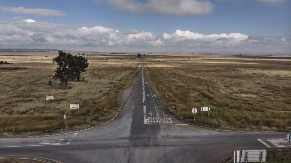 In this file photo taken on April 29, 2020 shows a deserted crossroads in the middle of farmland near Carletonville, as the government attempts to halt the spread of the new coronavirus (COVID-19).