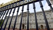 File: Buckingham Palace is seen through its perimeter fence in central London, Britain on October 24, 2014.