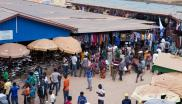 People are seen looking at clothing items in the Nyabugogo Market in Kigali, Rwanda July 31, 2018.