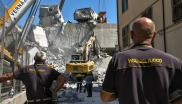 Rescue workers searching the rubble of a collapsed motorway bridge in Genoa found a car.