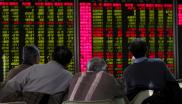 Men look at an electronic board showing stock information at a brokerage house in Beijing, China, 5 January 2016.