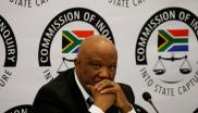 Former Deputy Finance Minister Mcebisi Jonas gestures ahead of the Judicial Commission of Inquiry probing state capture in Johannesburg on 24 August 2018.