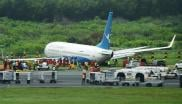 Some 157 passengers and eight crew were evacuated from the aircraft with no reported injuries.
