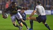 Bok captain Siya Kolisi (L) is tackled by Scotland's scrum-half Greig Laidlaw (C) and Scotland's flanker Hamish Watson (R) during the test match between Scotland and South Africa.