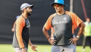 Captain of the Indian T20 cricket team Rohit Sharma (L) talks with coach Ravi Shastri during the team's practice session.