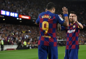 Luis Suarez (L) celebrates his goal with Lionel Messi at the Camp Nou Stadium in Barcelona.