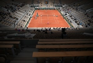 General view of the few spectators sit on the empty stands of the Philippe Chatrier court