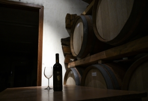 File: A bottle of red wine and a glass are pictured at Cagliero's Winery on April 23, 2020 in Barolo, Langhe Region, near Cuneo, northwestern Italy, during the country's lockdown aimed at curbing the spread of the COVID-19 infection, caused by the novel coronavirus.