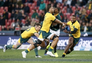 FILE: Australia's Lukhan Salakaia-Loto (L) tackles South Africa's Warrick Gelant during the 2019 Rugby Championship match, South Africa v Australia, at the Emirates Airline Park in Johannesburg, on July 20, 2019.